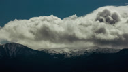 Stock Video Footage of Clouds over snowy mountain time lapse