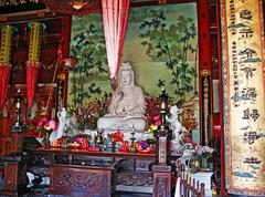 colourful buddhist  altar at a temple, china - stock photo