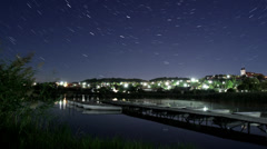 Tihany in moonlight with startrails Stock Footage