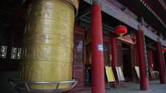 Golden prayer wheels in temple Stock Footage