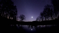 Zodiacal light and the Moon over a lake. Stock Footage