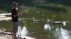 Sports Fisherman on lake Stock Footage