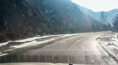 Driving down the mountain road with snow Stock Footage