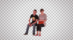 Boy & girl sitting on spectator seats Stock Footage
