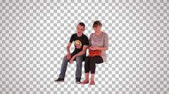 Stock Video Footage of boy & girl sitting on spectator seats