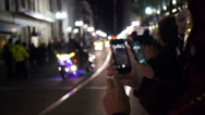Stock Video Footage of Tourists Record a Mardi Gras Parade on their iPhones 4109