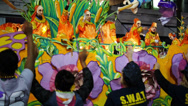 Stock Video Footage of People on a Mardi Gras Float Toss Beads to People Below 4121