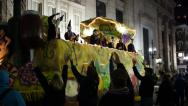 Stock Video Footage of People on a Passing Mardi Gras Float Toss Beads to People Below 4112