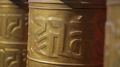 Golden prayer wheels in temple Stock Footage