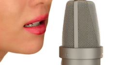 Young womans mouth microphone Stock Footage