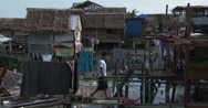 Stock Video Footage of 4K Slum Shanty Community Vulnerable Coastal Area