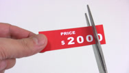 Stock Video Footage of Cutting the price tag 01