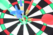 Stock Photo of darts on target.