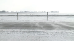 Snow Blowing Across Highway Close Up Stock Footage