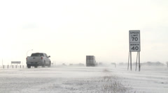 Stock Video Footage of Snow Blowing Across Highway Low Angle