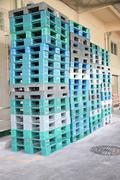 Plastic pallets are stacked can cause accidents. Stock Photos
