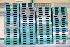 plastic pallets are stacked can cause accidents. - stock photo