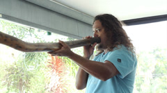 Kuku Yalanji man demonstrates Didgeridoo Stock Footage