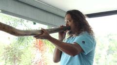 Kuku Yalanji man demonstrates Didgeridoo - stock footage