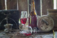 vintage wine barrel covered with cobweb at old village house - stock photo