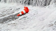 Stock Video Footage of Water flows on the orange traffic cone
