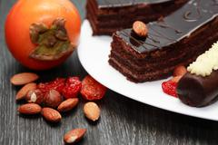 Sweets and fruits Stock Photos