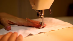 Woman sewing clothing at a sewing table Stock Footage