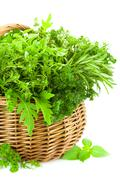 fresh spicy herbs in basket / isolated on white - stock photo