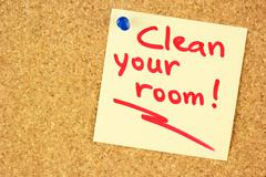 Clean your room sticker on the cork Stock Photos