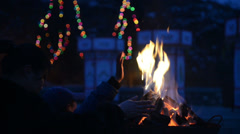The woman and children move towards the fire to get warm before the ceremony Stock Footage