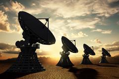 Radiotelescopes silouette at sunset Stock Illustration
