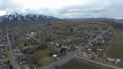 Aerial small rural town mountain valley HD 014 Stock Footage