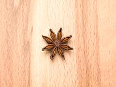 Star anise on a wooden background Stock Photos