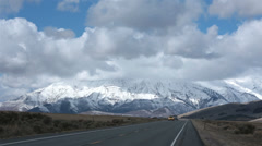 Traffic mountain valley road beautiful snow HD 2392 Stock Footage