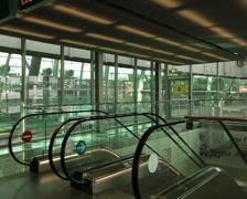 Dusseldorf airport sky train access escalators. Stock Footage