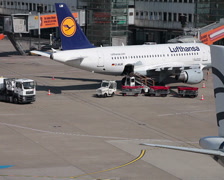 Tow tractor pushing aegean airlines jet airplane sx-dvg dusseldorf airport ap Stock Footage