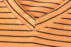 Orange alternating black t-shirt. Stock Photos