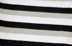 White alternating black t-shirt of textured. Stock Photos