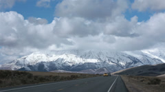 Traffic valley mountain snow covered winter fast HD 2392 Stock Footage
