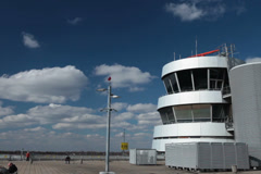 lufthansa jet airplane flying by control tower radar at dusseldorf airport. - stock footage