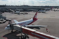 airberlin jet airplane docked to airbridge on dusseldorf airport apron. - stock footage