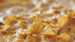Milk poured onto corn flakes in thin stream; close up; no people,  Stock Footage
