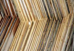 wooden planks stacked to be dried in the sun before processing industry - stock photo