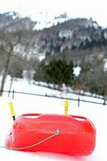 Red bob made of sturdy plastic on white snow for fun rides Stock Photos