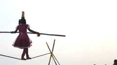 Slow motion young girl tightrope walker, Puducherry, India Stock Footage