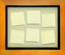 Yellow memo  paper on cork board isolated for text and background Stock Photos