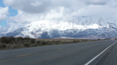 Truck drive valley road mountain snow winter HD 2394 Stock Footage