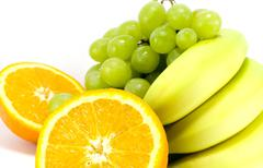 Grapes, bananas and two halves of orange Stock Photos