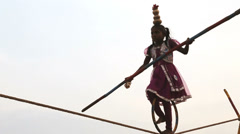 Slow motion young girl tightrope walker, Pondicherry, India Stock Footage