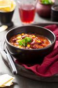 Mexican chili con carne in black bowl Stock Photos